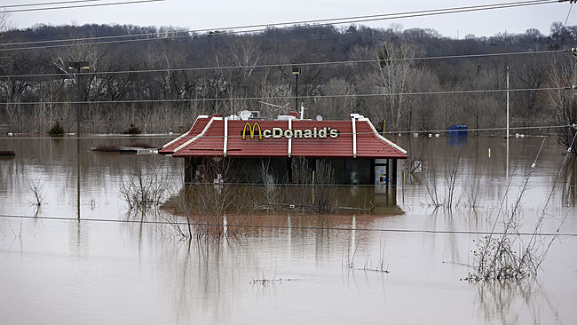 Floodwater from the Bourbeuse River surrounds a McDonald's restaurant, Tuesday, Dec. 29, 2015, in Union, Mo. Flooding across Missouri has forced the closure of hundreds of roads and threatened homes. (AP Photo/Jeff Roberson)