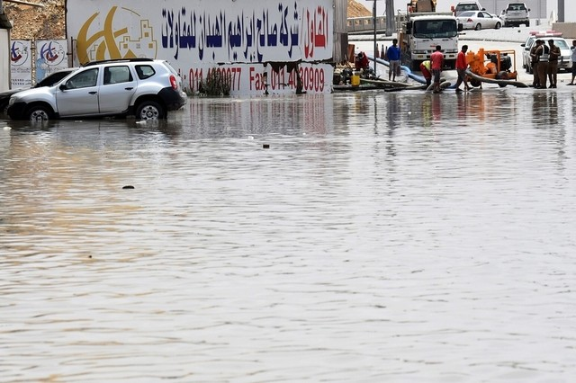 Municipal workers pump water from a flooded street in Riyadh after heavy rainfall across the Saudi capital. Fayez Nureldine / AFP Photo